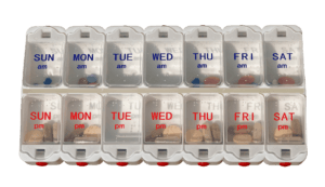pills dispenser with daily markers