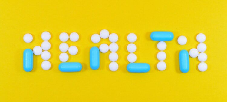 medication pills on a yellow surface